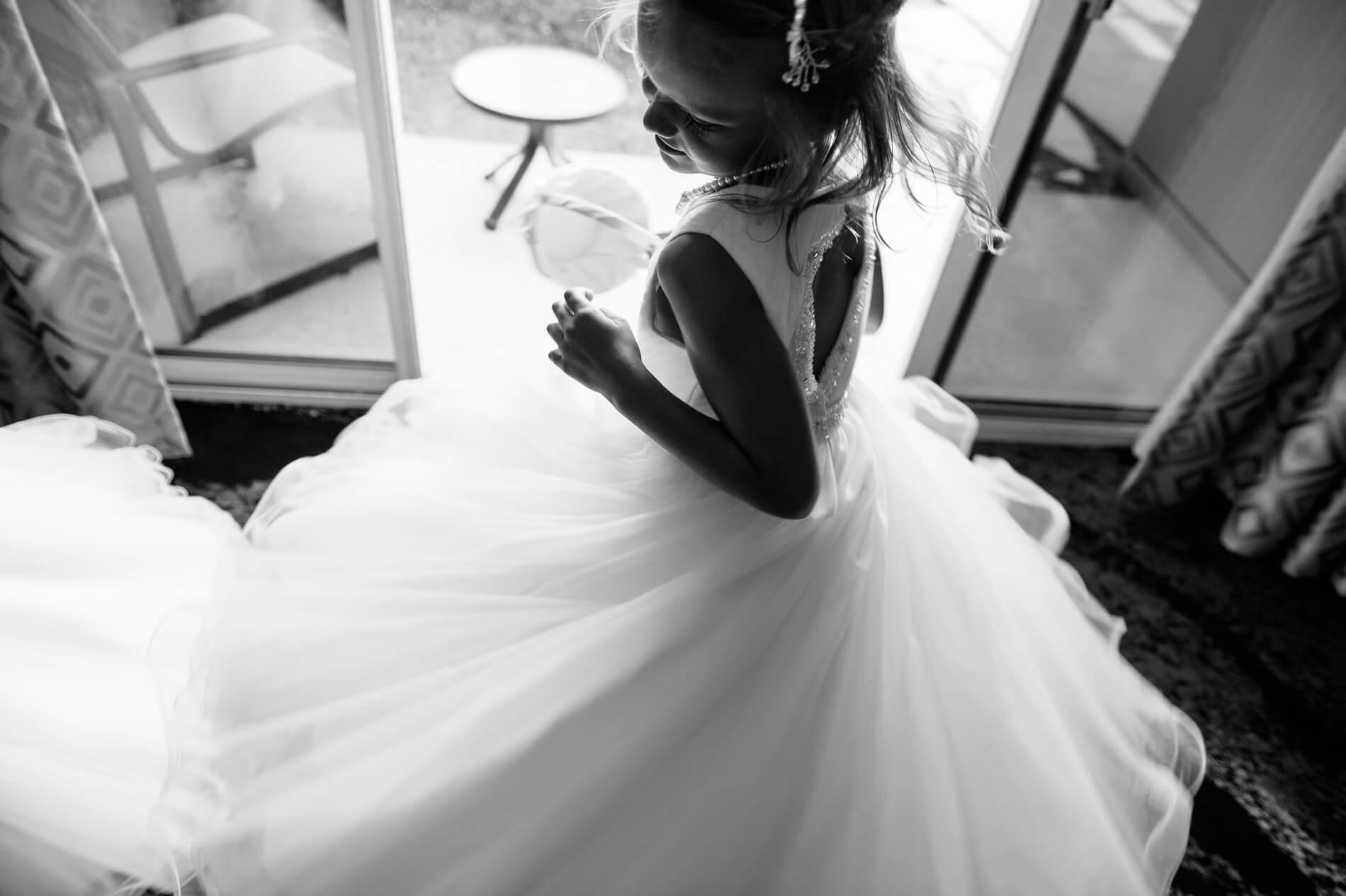 flower girl spins in bridal suite before wedding