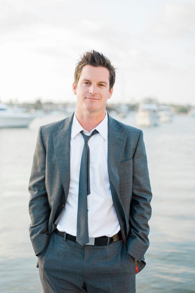 man in gray suit portrait newport harbor yacht club