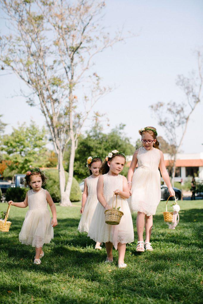 flower girls walk down aisle inn at rancho santa fe wedding