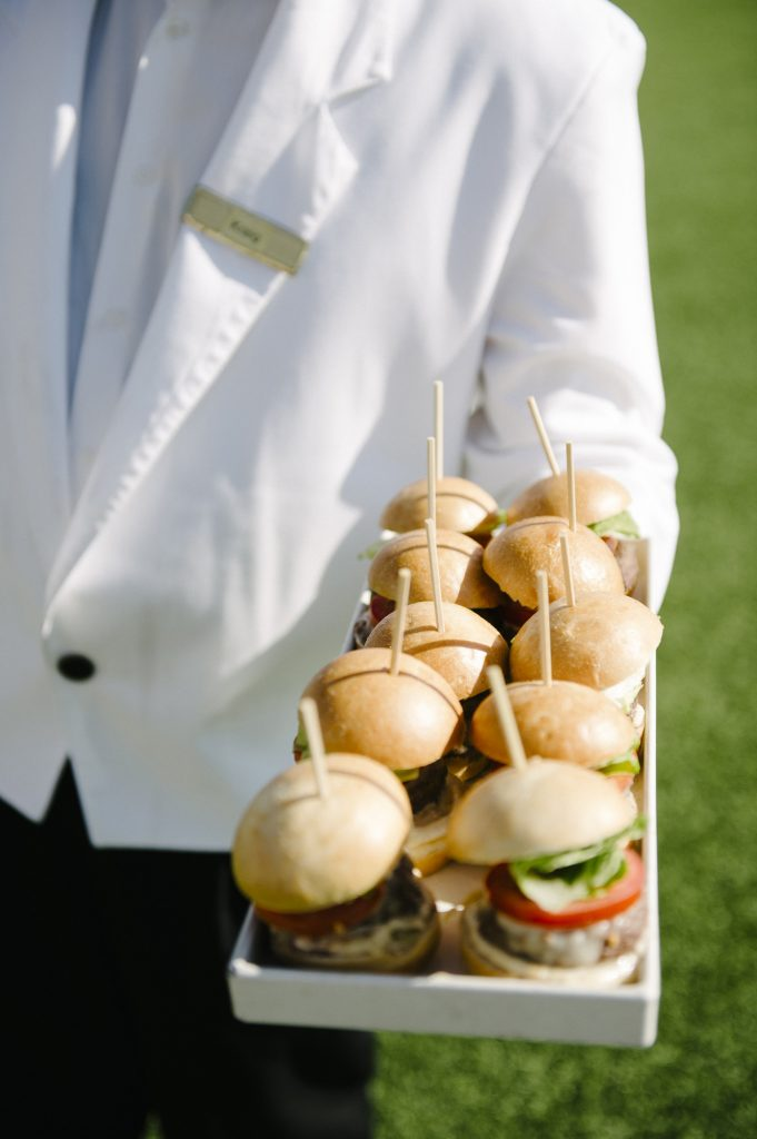 server holds tray of slider appetizers windsor lawn cocktail hour