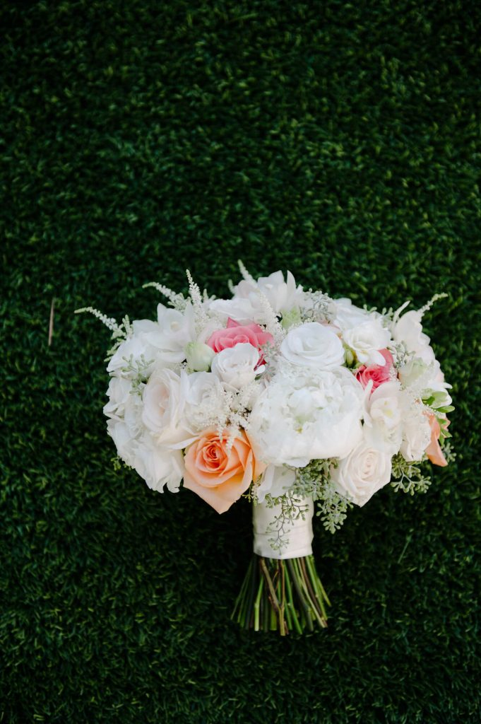 bridal bouquet with white orange and pink roses