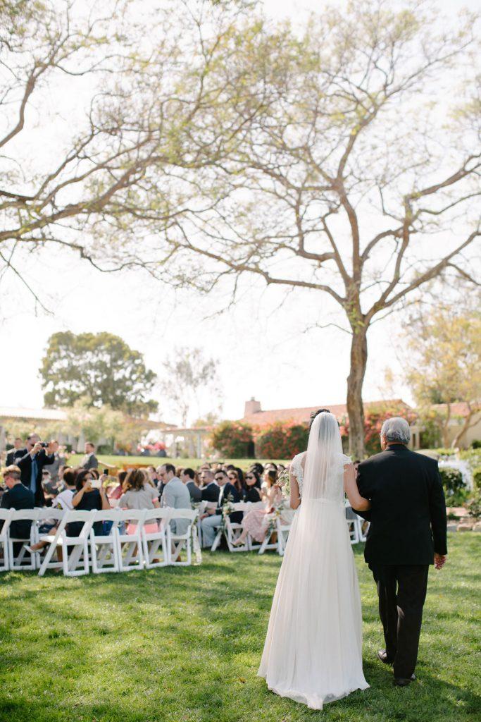 bride and father walk down aisle inn at rancho santa fe wedding