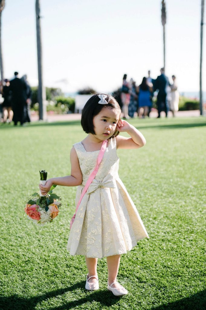young flower girl holds bouquet windsor lawn cocktail hour