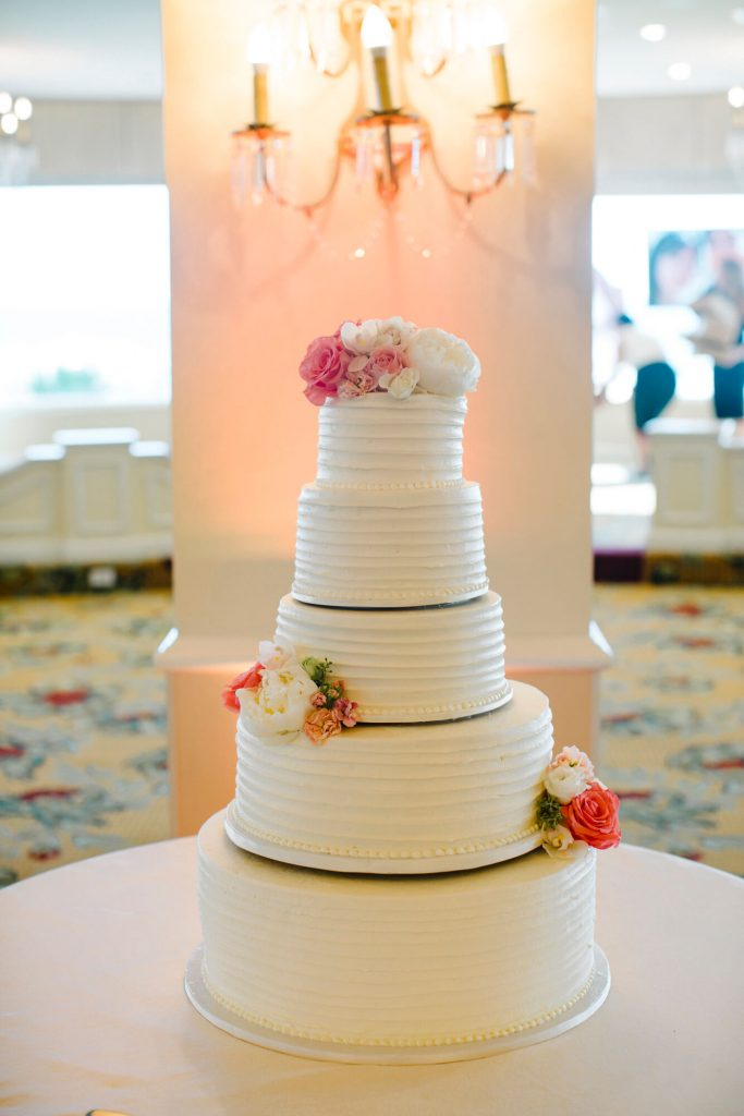five tier wedding cake with pink and white roses