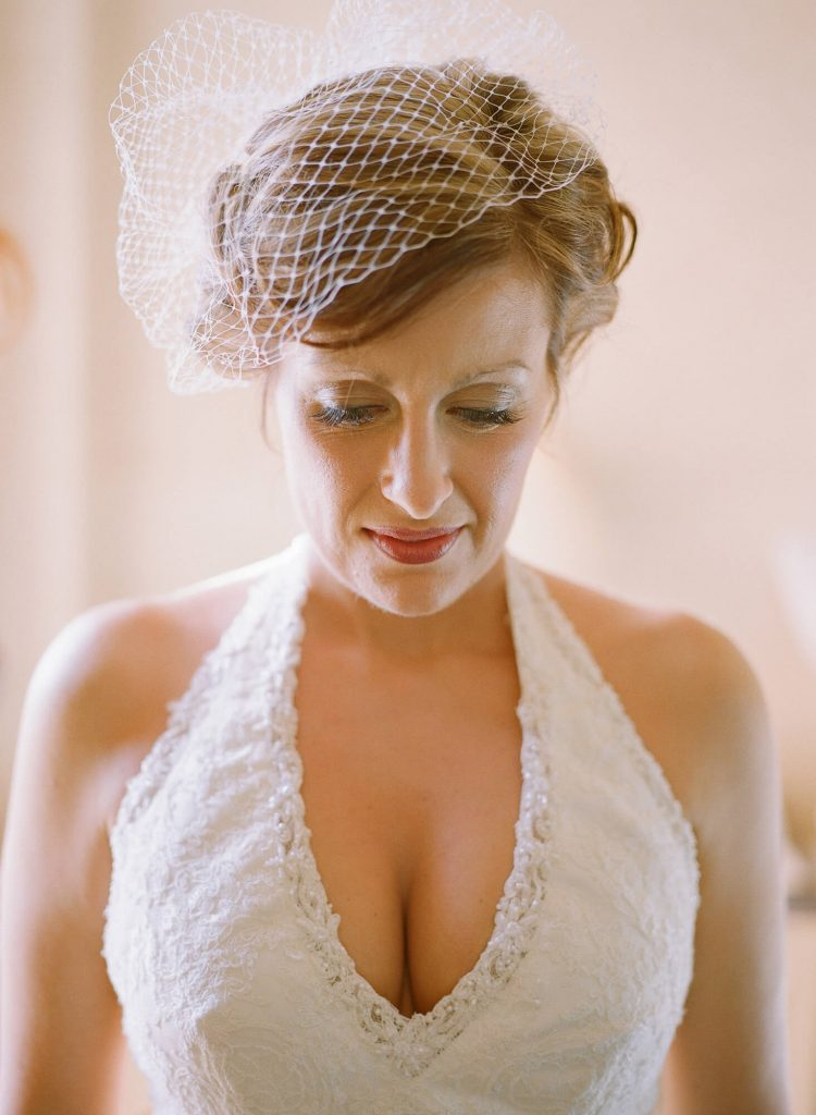bride in vintage gown and birdcage veil