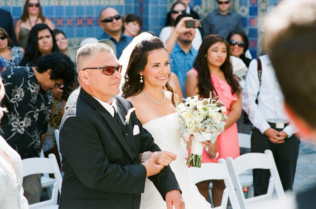 bride walking with father down aisle wrigley memorial wedding