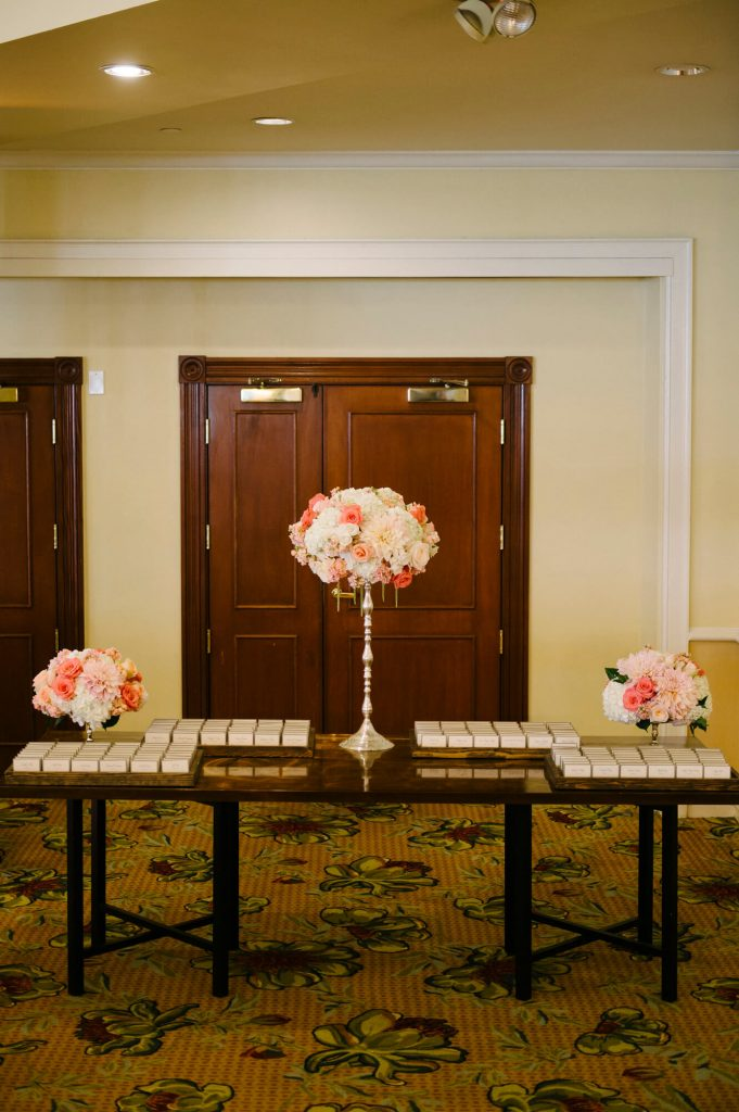 escort cards on table tall vase flowers