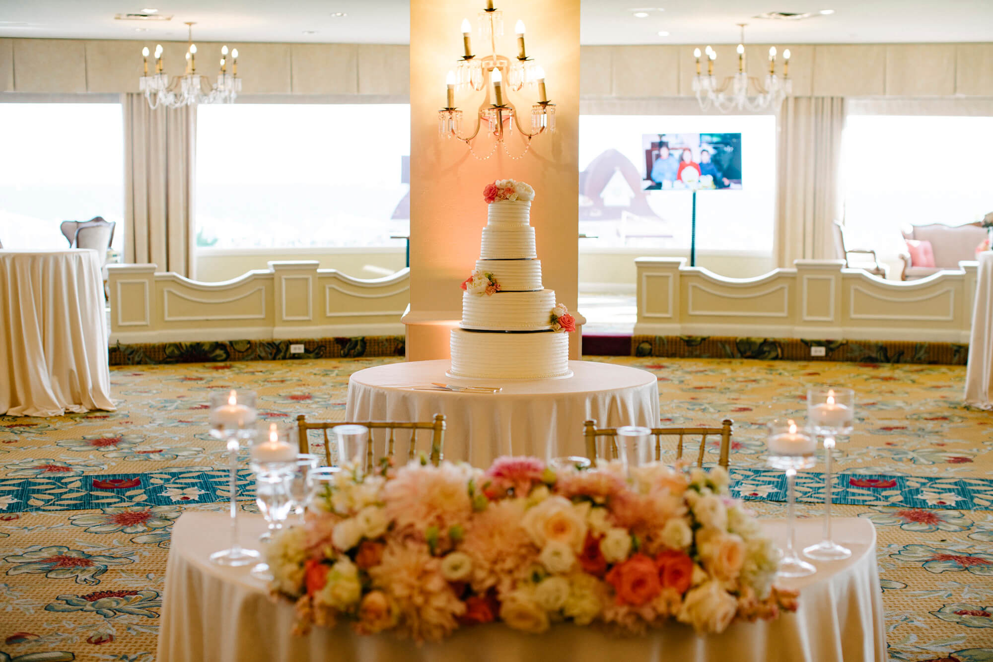 sweetheart table and five tier cake in ballroom at hotel del wedding reception