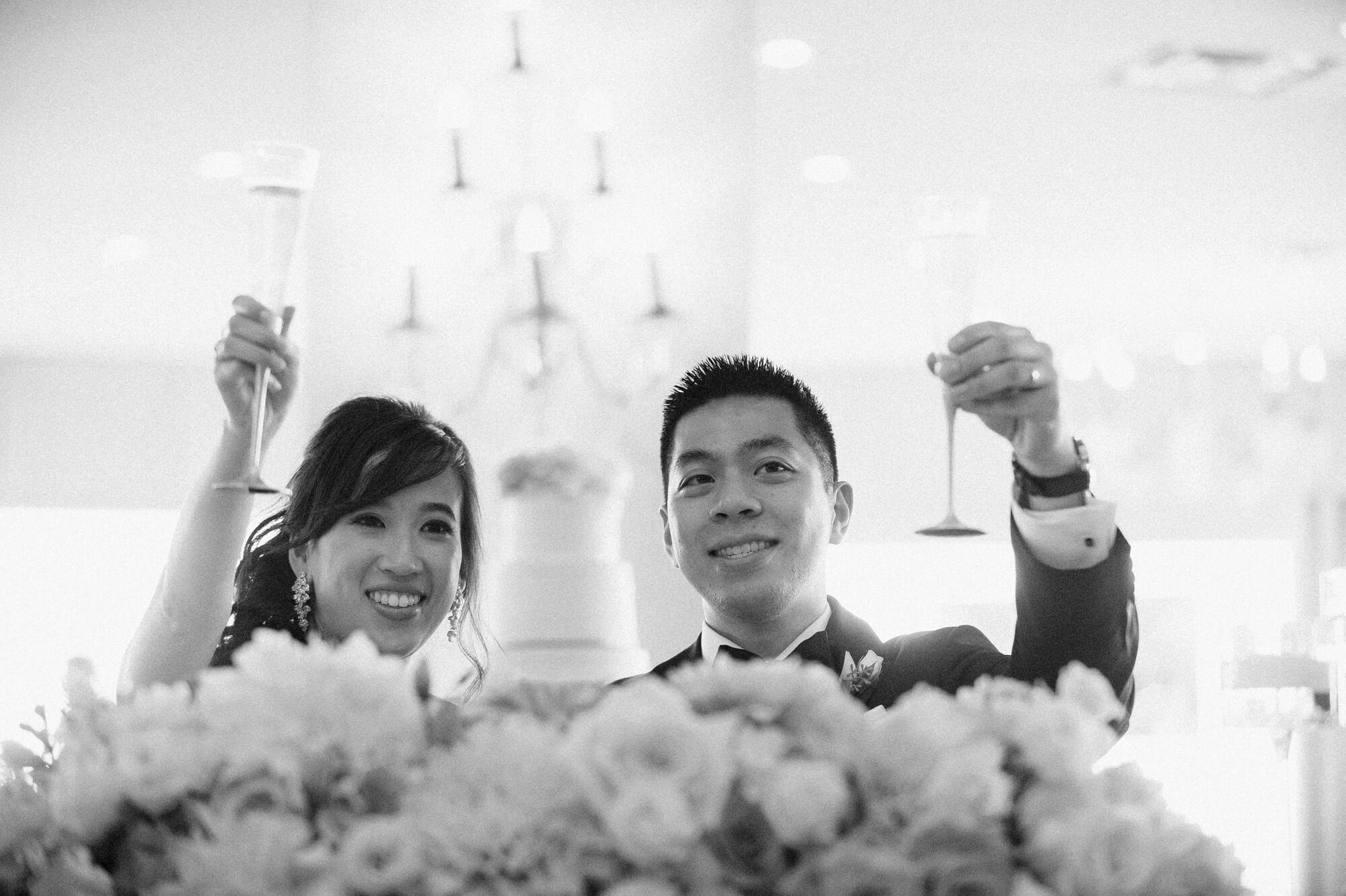 bride and groom smile and cheers champagne hotel del wedding reception