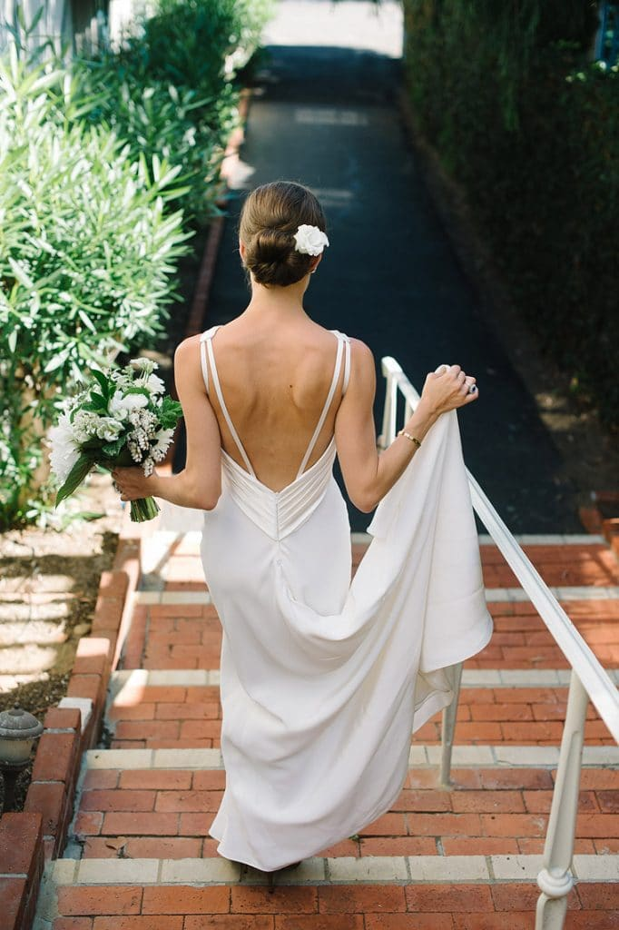 bride walking down steps in susan neville gown
