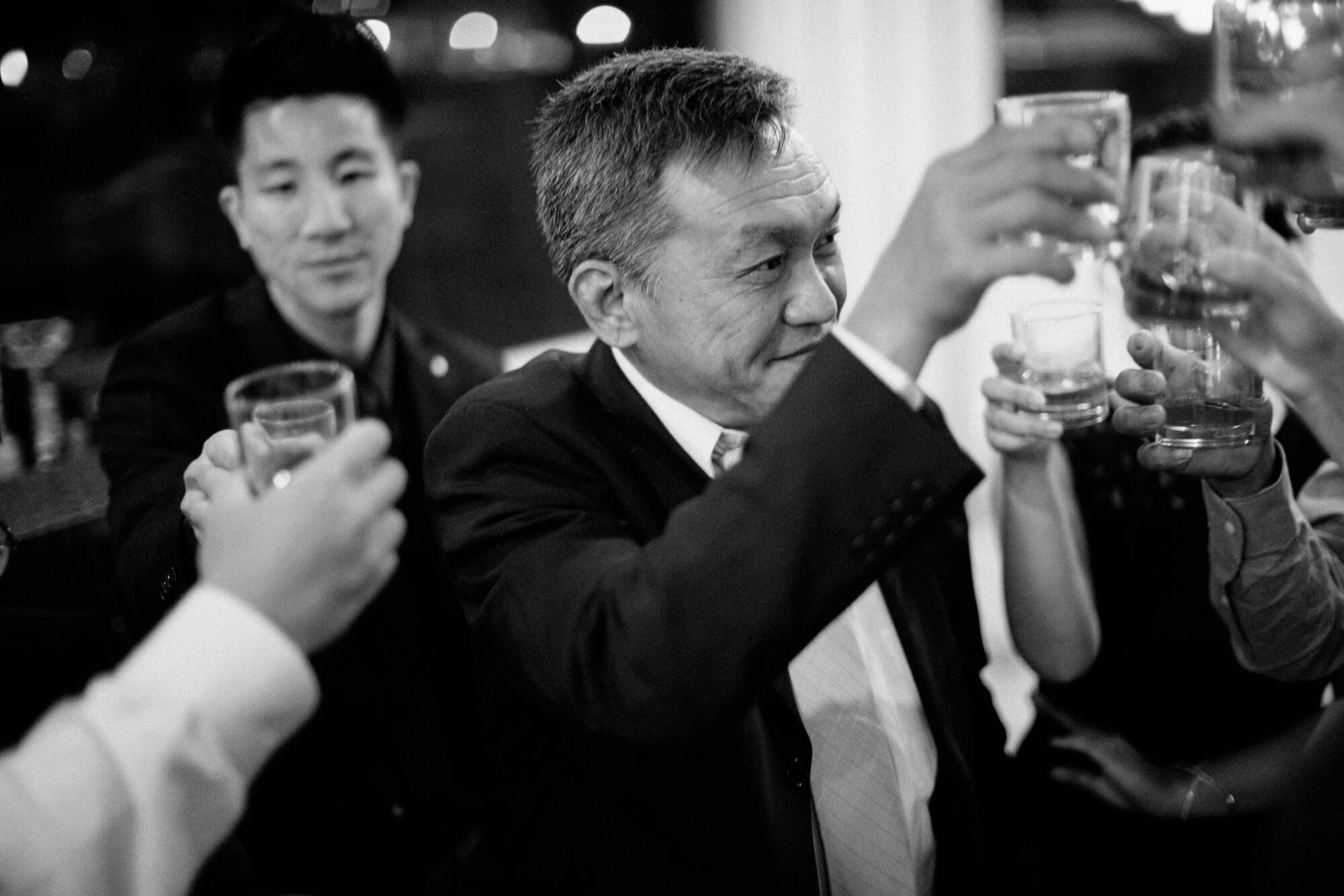 wedding guests raise glasses tequila shots