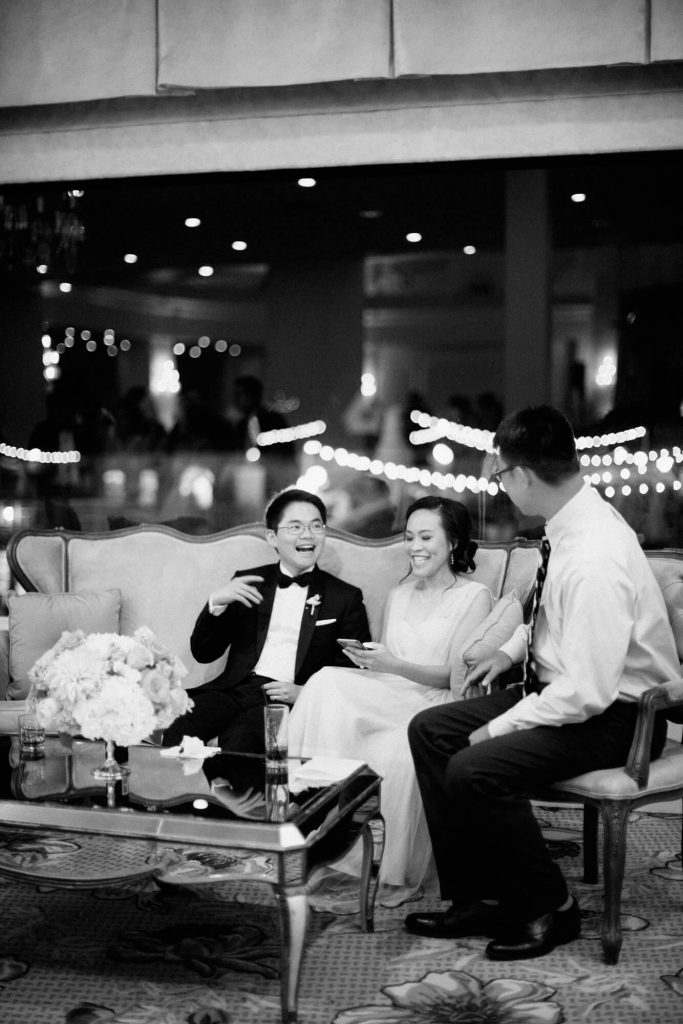 wedding guests sit on lounge furniture hotel del ballroom reception