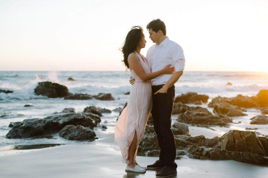 couple embracing at el matador beach malibu engagement photo
