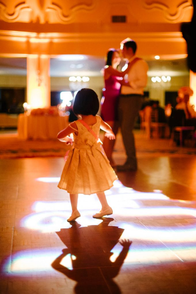 young flower girl dances alone on dance floor hotel del coronado ballroom