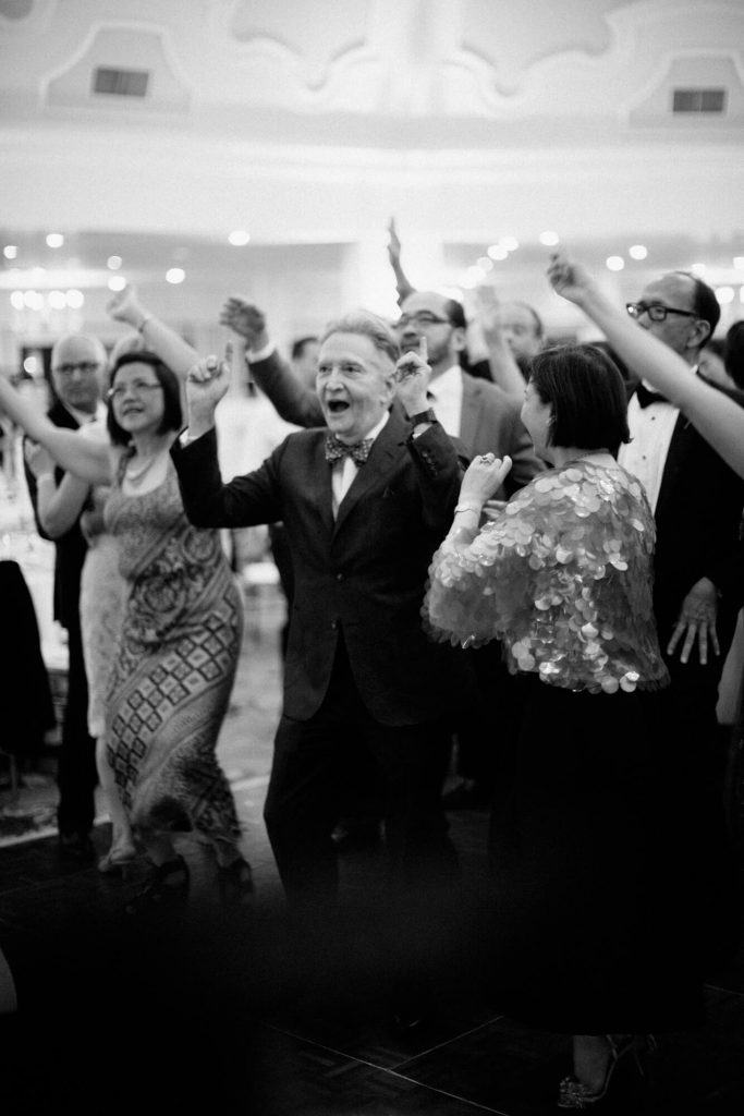 guests dance cheer for wedding band hotel del coronado ballroom reception