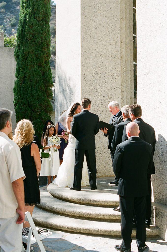 bride groom holding hands altar wrigley memorial wedding catalina island