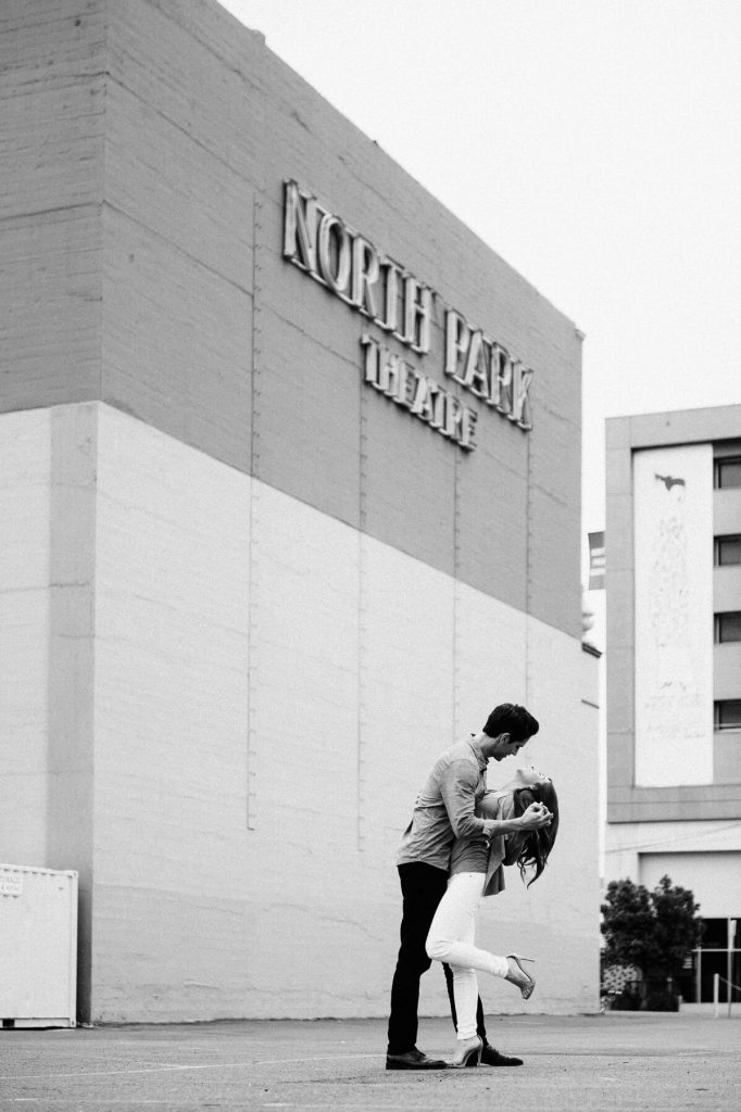couple posing in front of north park theater urban san diego engagement