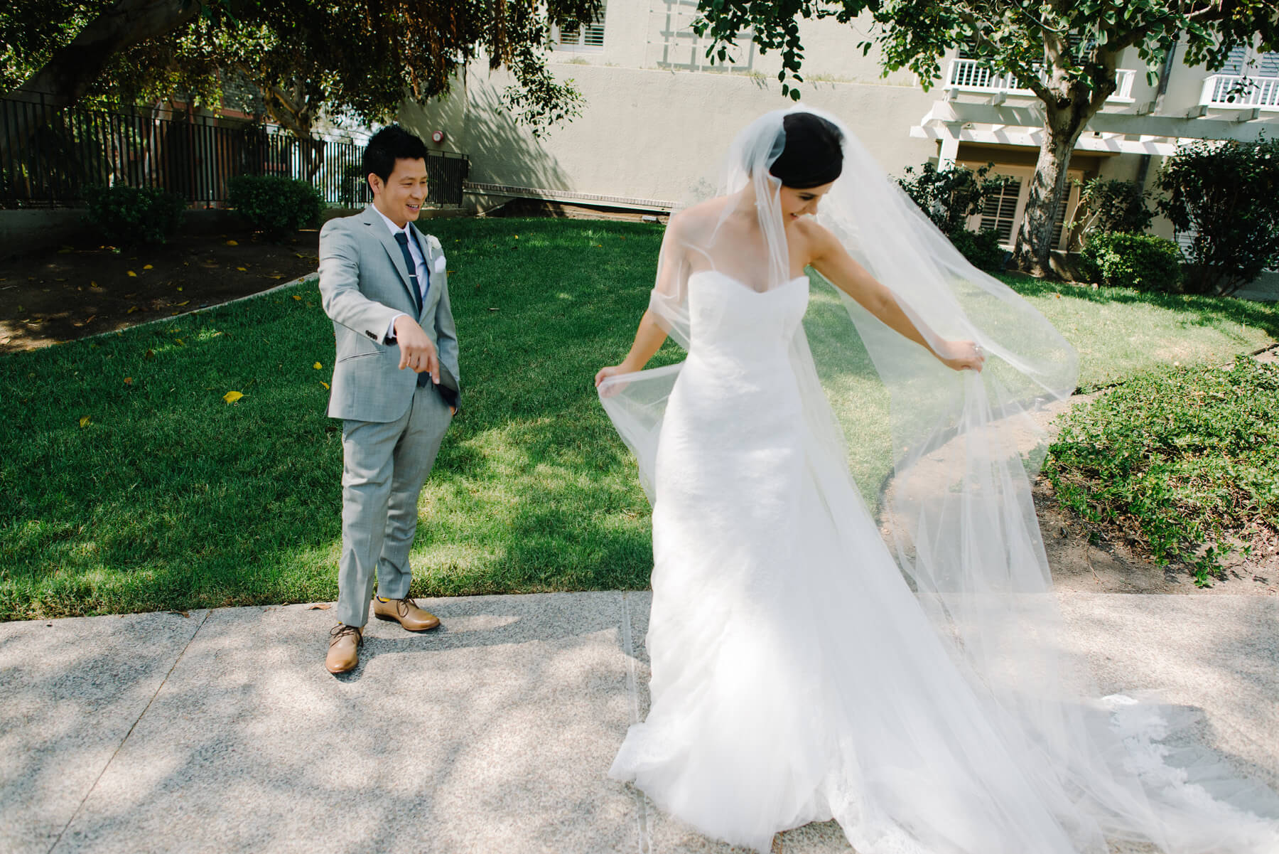 bride spins for groom during first look at lauberge del mar
