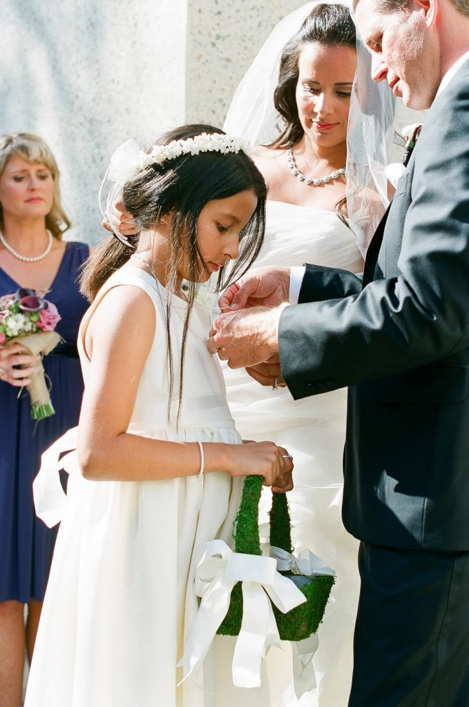 groom putting necklace on stepdaughter catalina island wedding wrigley memorial