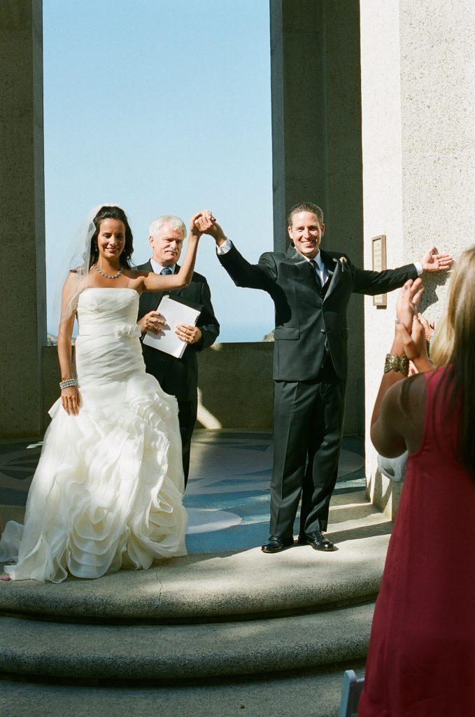 bride and groom raising hands catalina island wedding wrigley memorial