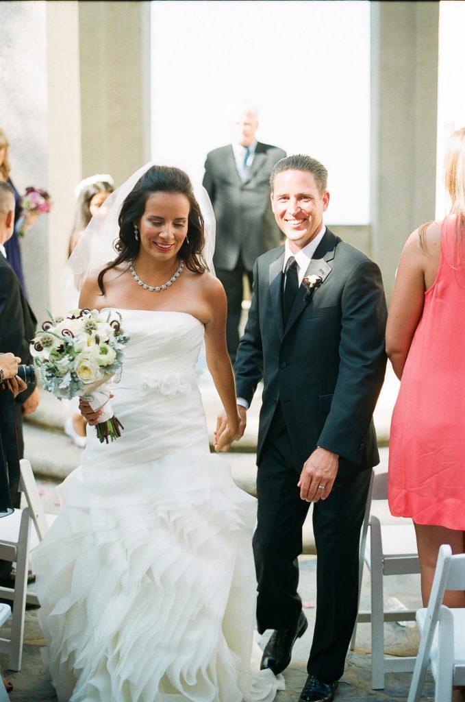 bride and groom walking down aisle after wrigley memorial wedding catalina island