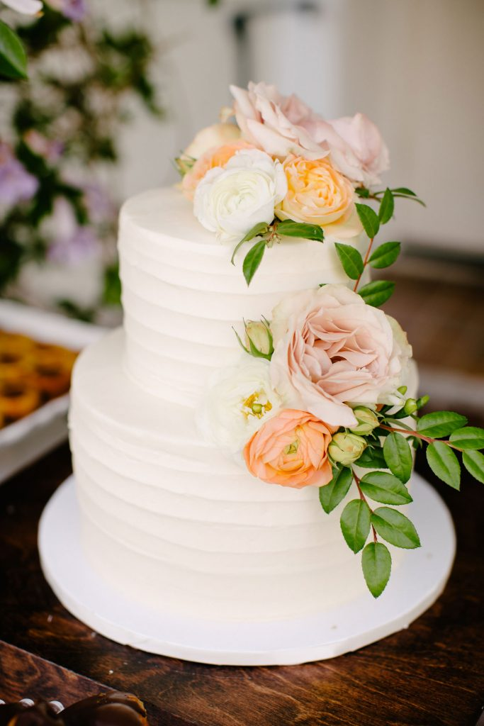 two tier wedding cake with peonies