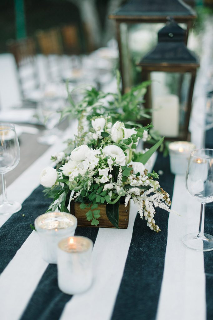 white flowers on blue and white table runner