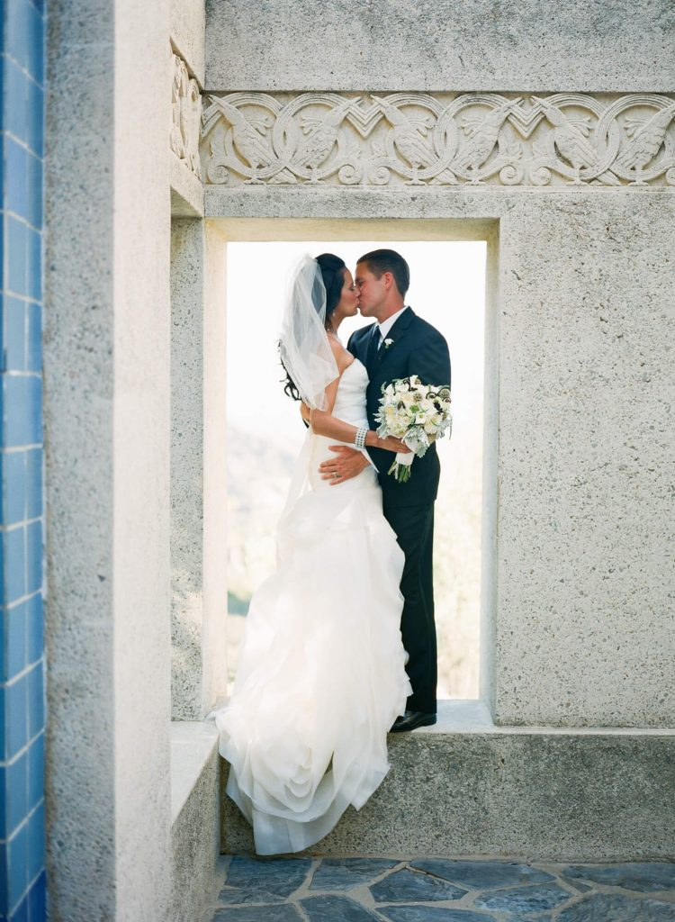 bride and groom standing in opening at wrigley memorial