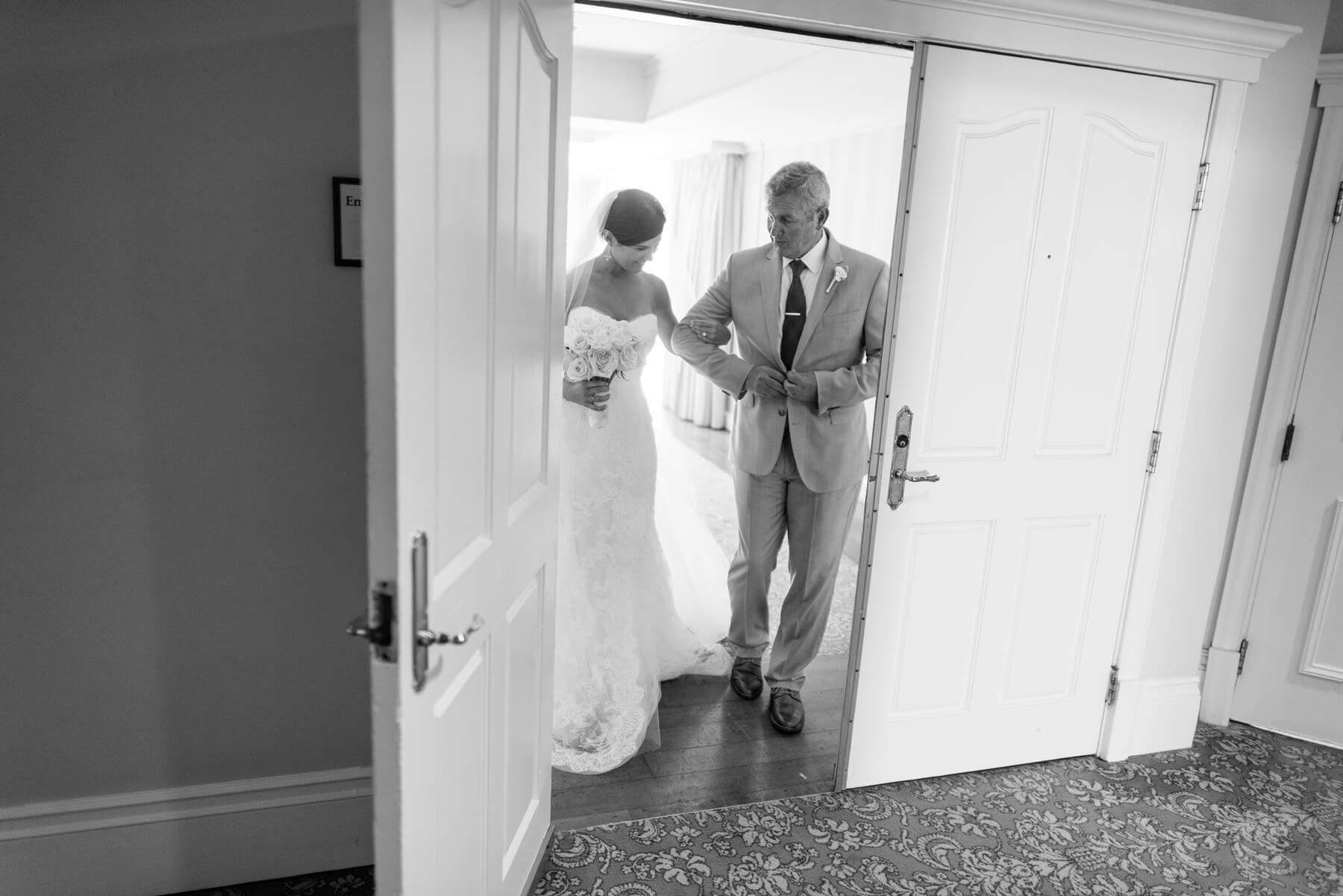 bride and father walking through door toward ceremony at lauberge del mar