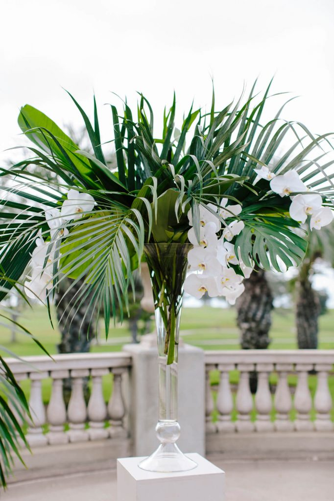 vase with orchid and palm leaves hilton la jolla torrey pines wedding