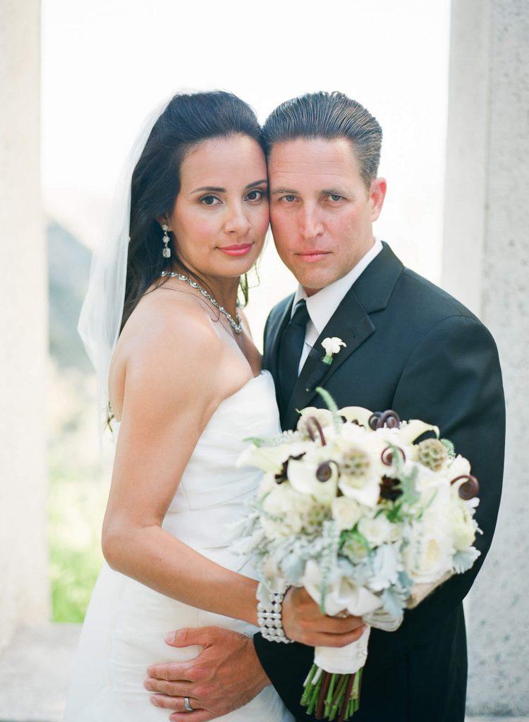 groom and bride posing at wrigley memorial