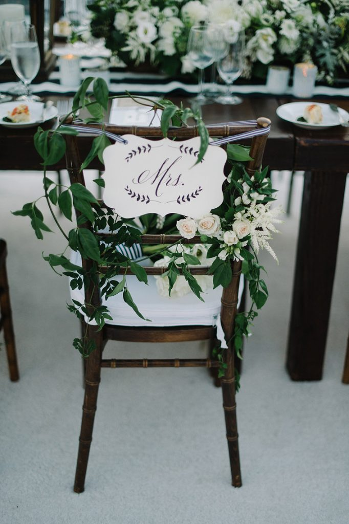 mrs sign on back of brides chair