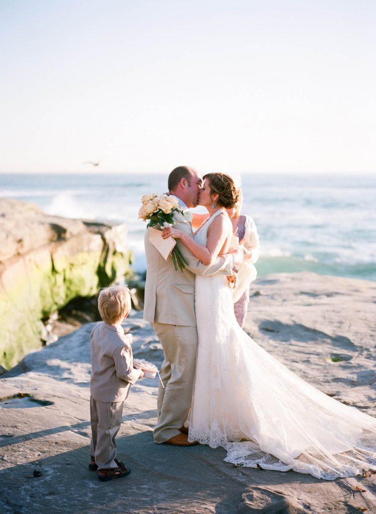 bride groom kiss rocks windansea beach wedding