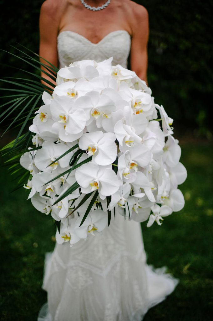 large bouquet with white orchids and palm leaves