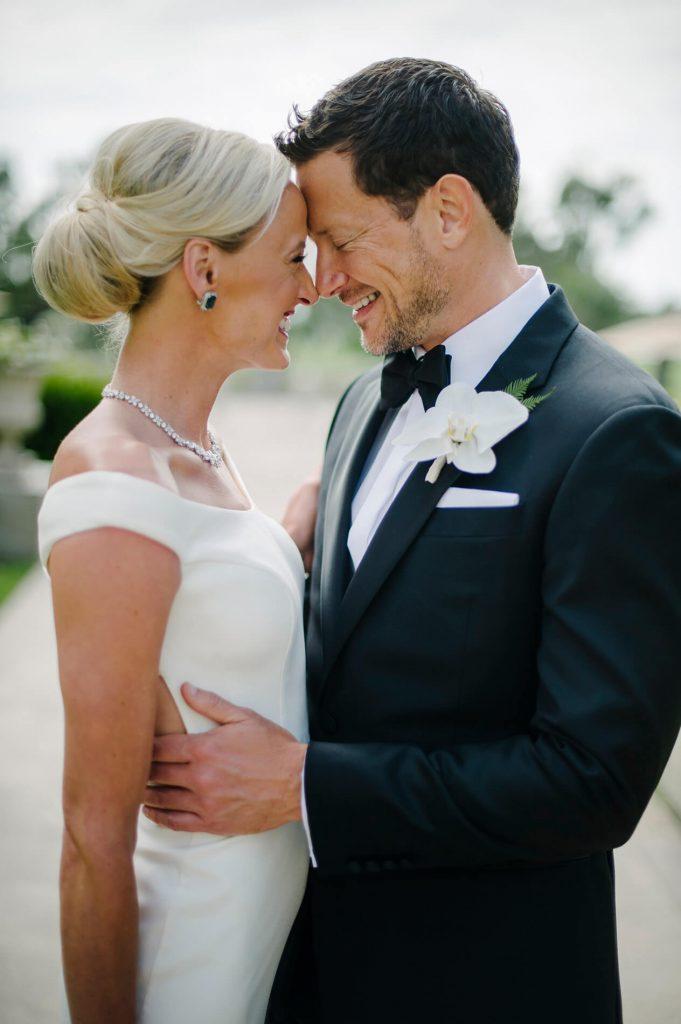 bride and groom embracing la jolla torrey pines wedding