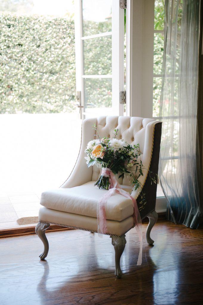 bridal bouquet sitting on chair rancho santa fe wedding