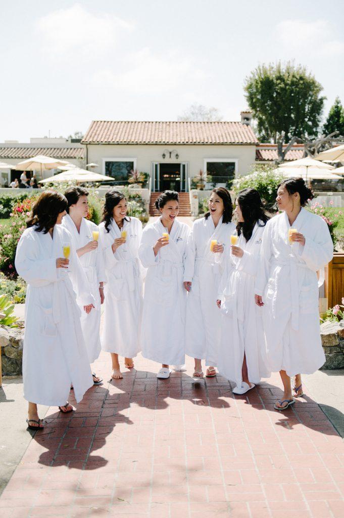 bride and bridesmaids walk in robes inn at rancho santa fe wedding