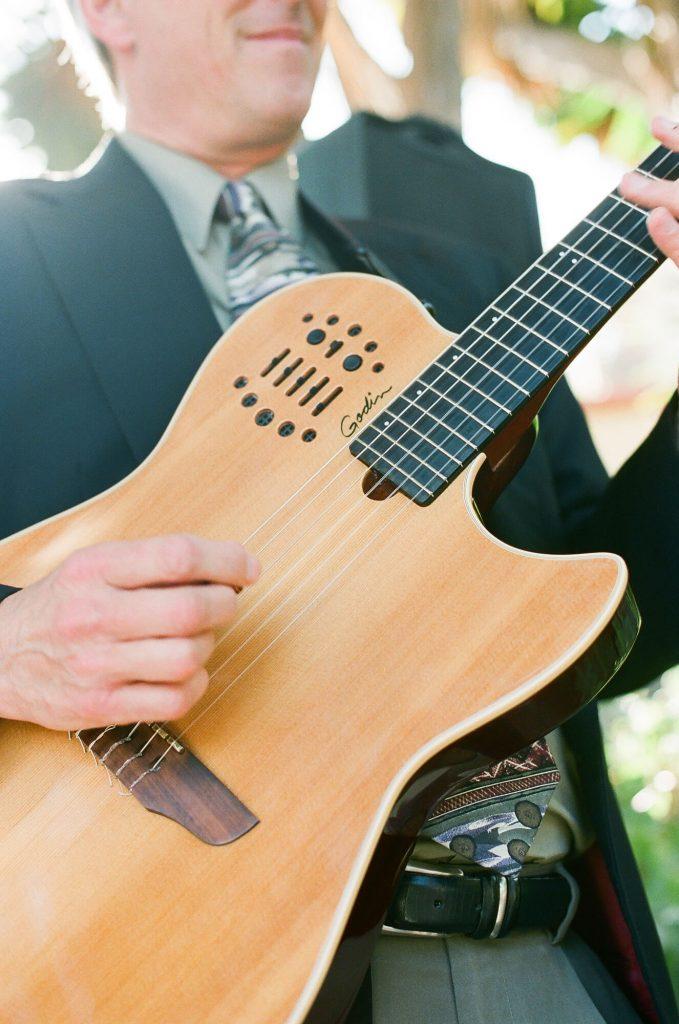 man playing guitar at catalina island wedding
