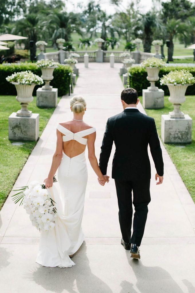 bride and groom walking hilton la jolla torrey pines wedding