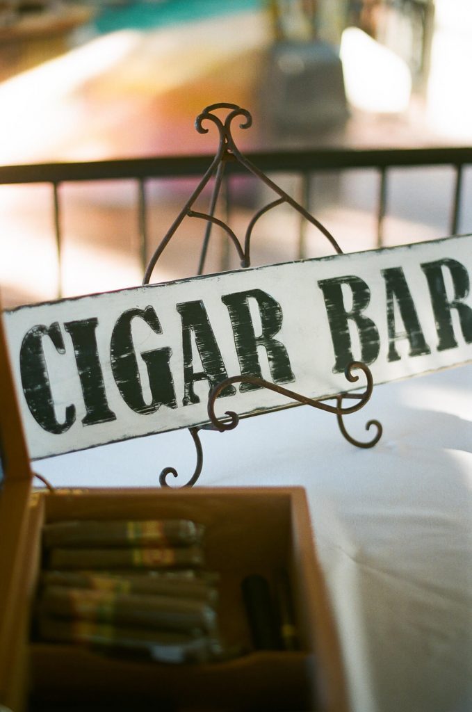 cigar bar sign with cigars