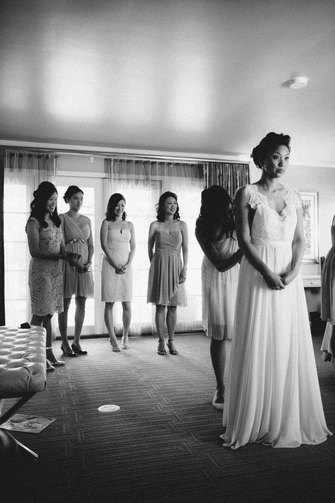 bridesmaid helping bride into gown inn at rancho santa fe wedding