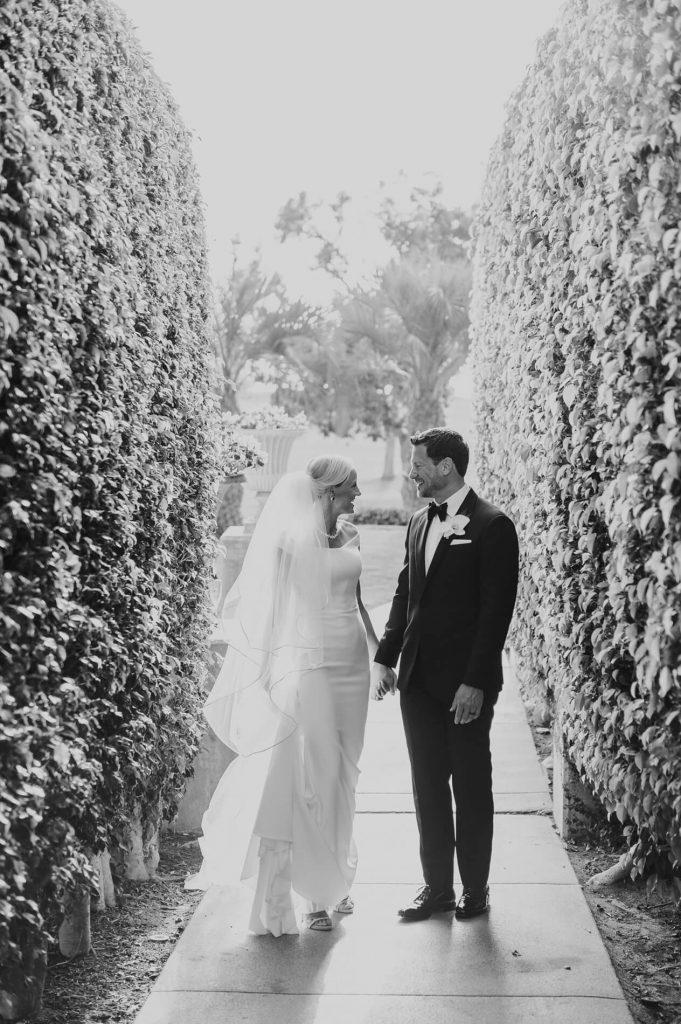 bride and groom holding hands between hedges hilton la jolla torrey pines