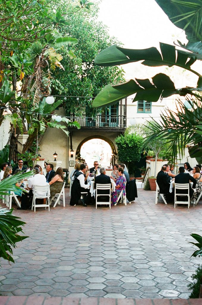 guests in restaurant courtyard for catalina island wedding