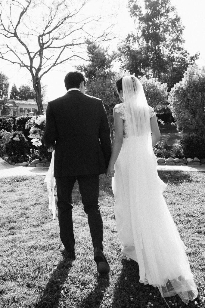 bride and groom walk in garden inn at rancho santa fe wedding
