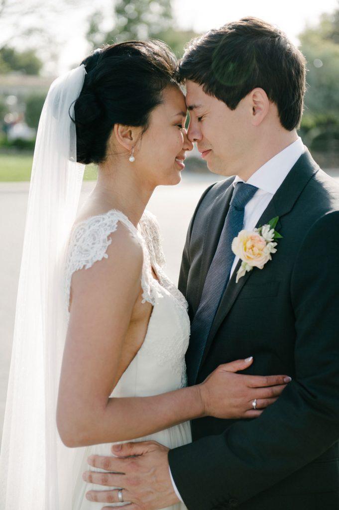 bride and groom embrace inn at rancho santa fe wedding