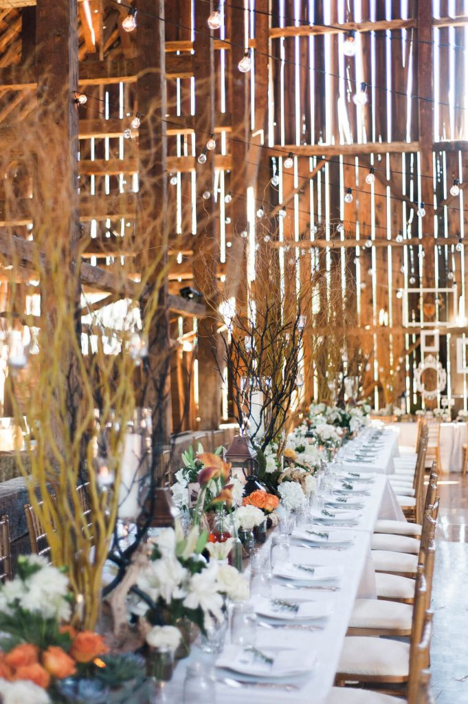 long tables with willow centerpieces rustic barn wedding lake almanor