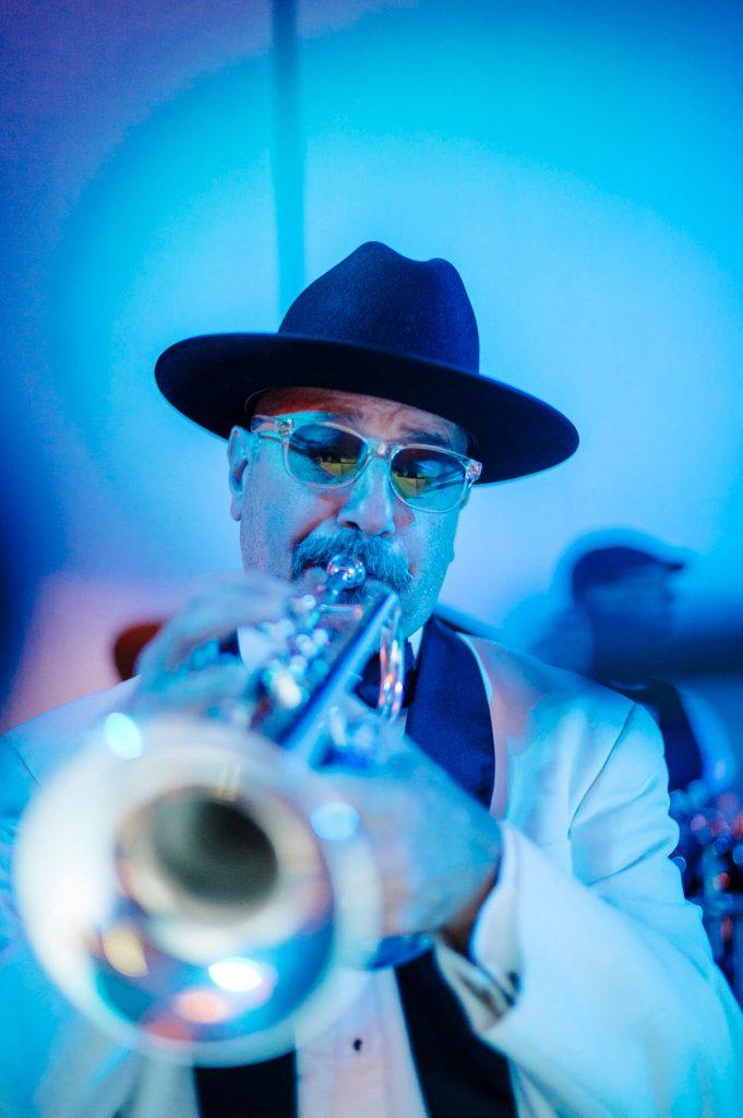 band member playing trumpet wedding reception