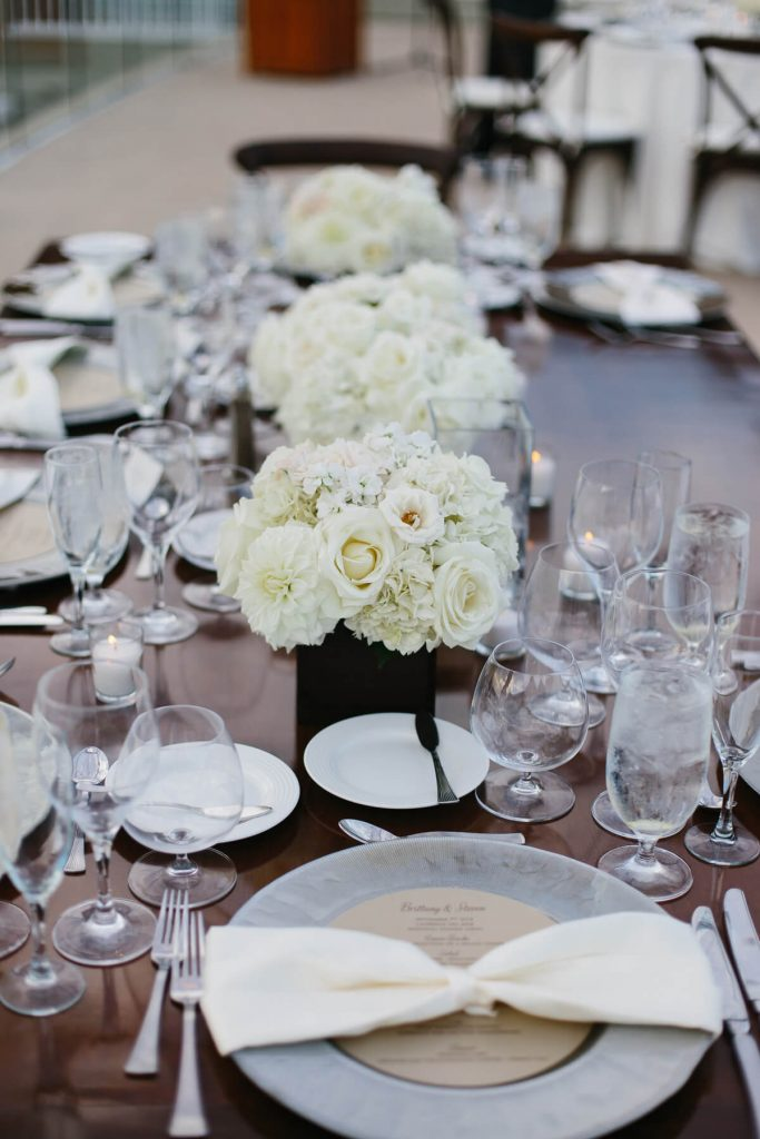 white flowers centerpiece san diego beach wedding lauberge del mar