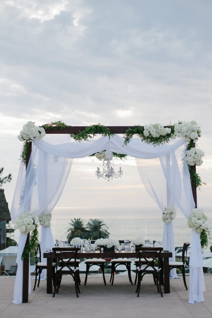 head table under wedding arch lauberge del mar pacific terrace