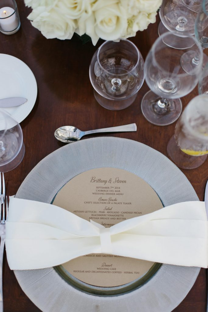 place setting with dinner menu on wooden table lauberge del mar
